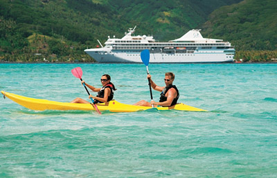 Kayaking in the beautiful water on a Paul Gauguin cruise. Photo courtesy of Paul Gauguin Cruises.
