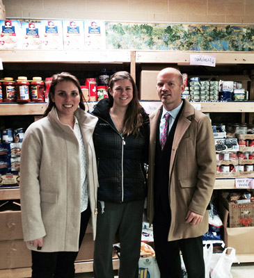 Team members (from left) Caroline Thomas and Sammie Kroll join Cruise Web President Frans Hansen to deliver our donations to the College Park Community Food Bank.