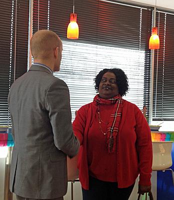 Gloria shakes Frans' hand.