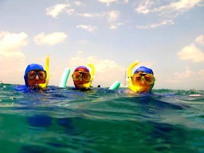 Sporty family snorkeling
