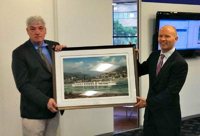 Cruise Web President Frans Hansen (right) accepts the award from Uniworld's Walter Nadratowski.