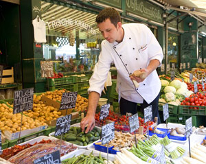 Selecting fresh produce - Courtesy of Uniworld Boutique River Cruise Collection