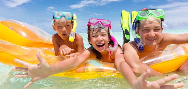 Children on Beach Raft
