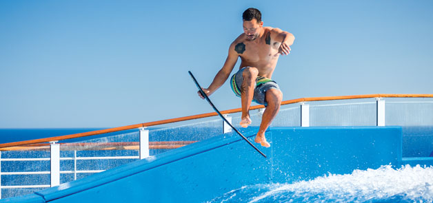 Catch some waves on the Flowrider on the renovated Mariner of the Seas from Royal Caribbean.