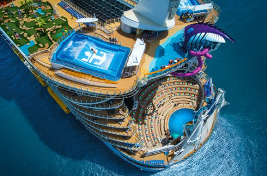 Back of Symphony of the Seas features a waverunner, waterslides, and pools.