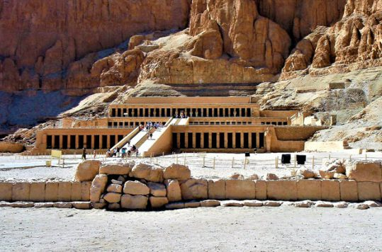 Tourists walk up to the temple of Hatshepsut in Luxor, Egypt.
