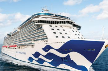 Sky Princess sailing in blue water with Sea Witch logo on front of ship
