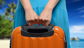 Woman holding suitcase