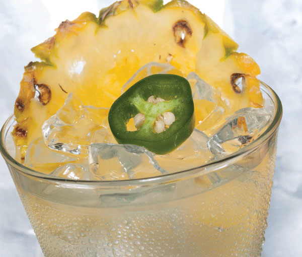 A Hawaiian beverage with pineapple and jalapeno
